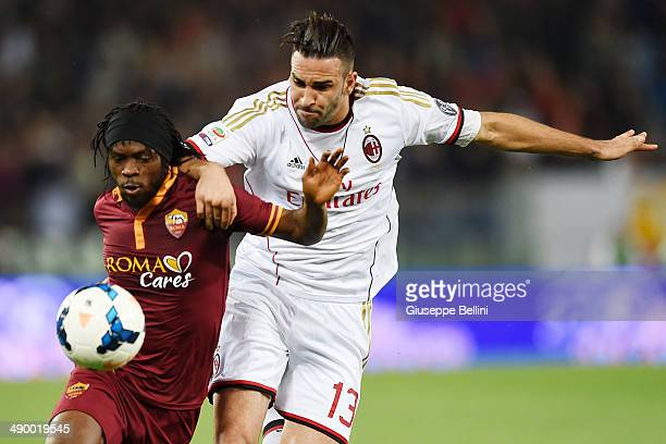 Gervinho of Roma and Adil Rami of Milan in action during the Serie A match between AS Roma and AC Milan at Stadio Olimpico on April 25 2014 in Rome...
