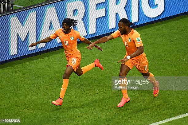 Gervinho of the Ivory Coast celebrates scoring his team's second goal with teammate Didier Drogba during the 2014 FIFA World Cup Brazil Group C match...