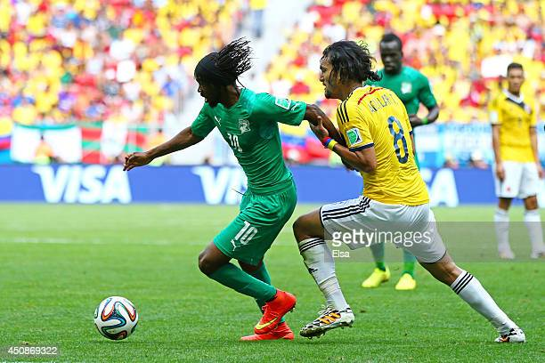 Gervinho of the Ivory Coast controls the ball against Abel Aguilar of Colombia during the 2014 FIFA World Cup Brazil Group C match between Colombia...