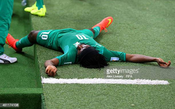Gervinho of the Ivory Coast lies on the ground during the 2014 FIFA World Cup Brazil Group C match between Greece and Cote D'Ivoire at Estadio...
