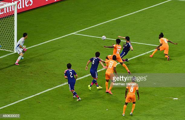 Gervinho of the Ivory Coast scores his team's second goal on a header past goalkeeper Eiji Kawashima of Japan during the 2014 FIFA World Cup Brazil...