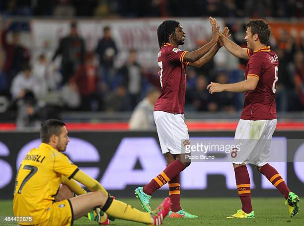 Gervinho with his teammate Adem Ljajic of AS Roma celebrate after scoring the third team's goal during the Serie A match between AS Roma and Atalanta...