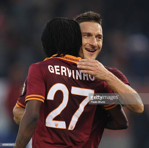 Gervinho with his teammate Francesco Totti of AS Roma celebrates after scoring the fourth team's goal during the Serie A match between AS Roma and...