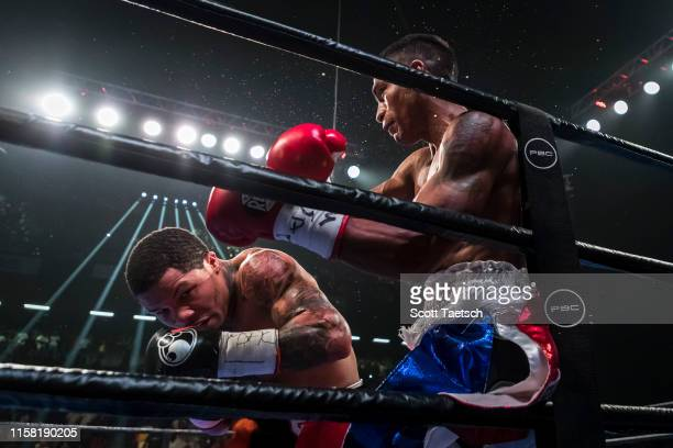 Gervonta Davis and Ricardo Nunez in action during the second round of their WBA super featherweight championship fight at Royal Farms Arena on July...
