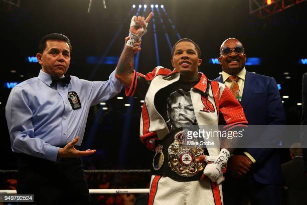 Gervonta Davis celebrates after he TKO's Jesus Cuellar in the third round to win the WBA Super Featherweight Championship bout at Barclays Center on...