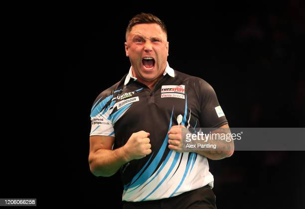 Gerwyn Price celebrates a draw in his match against Michael Smith during day two of the Unibet Premier League at Motorpoint Arena on February 13 2020...