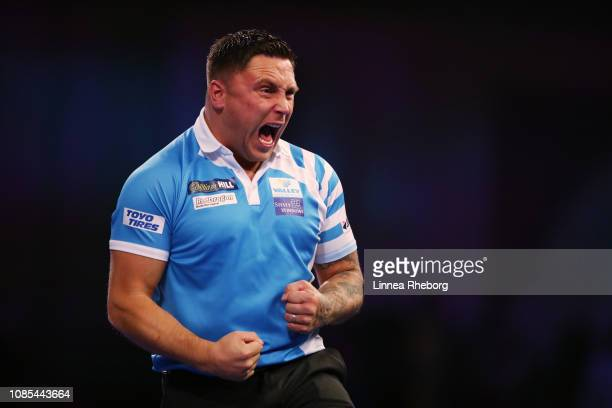Gerwyn Price of Wales celebrates during his second round match against Nathan Aspinall of England during Day Nine of the 2019 William Hill World...