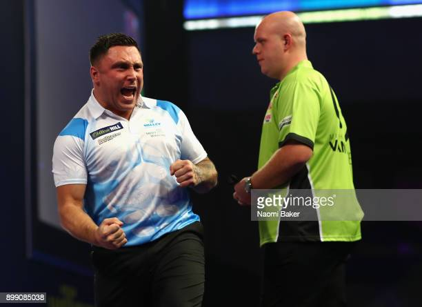 Gerwyn Price of Wales celebrates winning a leg during his third round match against Michael van Gerwen of the Netherlands on day eleven of the 2018...