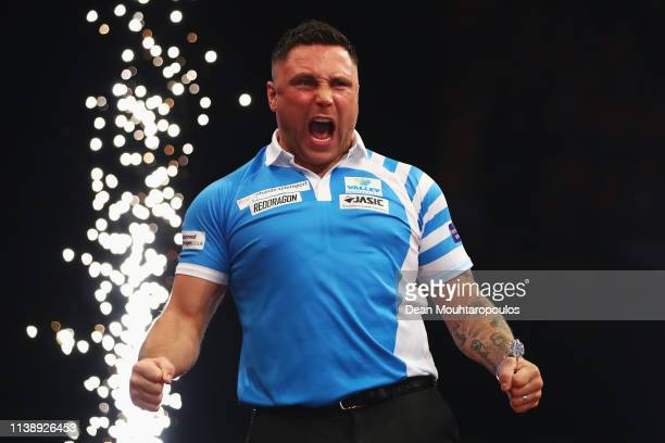 Gerwyn Price of Wales competes celebrates victory against Peter Wright of Scotland during day two of the 2019 Unibet Premier League Darts on March 28...