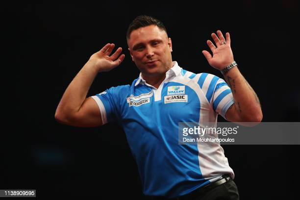 Gerwyn Price of Wales reacts as he competes against Peter Wright of Scotland during day two of the 2019 Unibet Premier League Darts on March 28 2019...