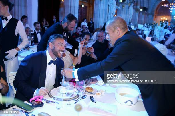 Gery Keszler is seen serving his guests soup at the LIFE Solidarity Gala prior to the Life Ball at City Hall on June 2 2018 in Vienna Austria The...