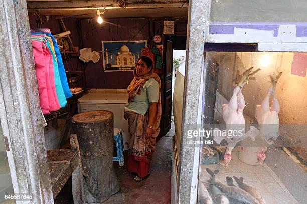 Geschäft für Frischfisch und Hühnerfleisch in einer Kleinstadt in Mangan