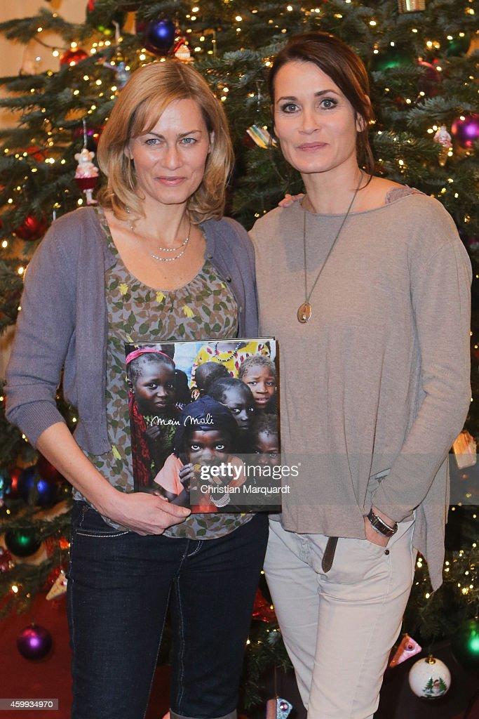 Gesine Cukrowski and Anja Kling attend the 'Mein Mali' Book Presentation at Komische Oper on December 4, 2014 in Berlin.