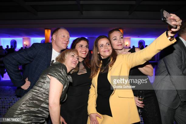 Gesine Cukrowski Simon Schwarz Katharina Wackernagel Rebecca Immanuel and Lisa Maria Potthoff take a selfie during the ARD advent dinner hosted by...