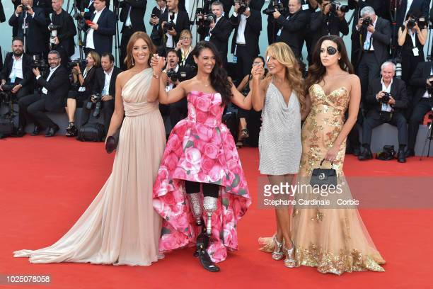 Gessica Notaro Jo Squillo Giusy Versace and Francesca Carollo walk the red carpet ahead of the opening ceremony and the 'First Man' screening during...