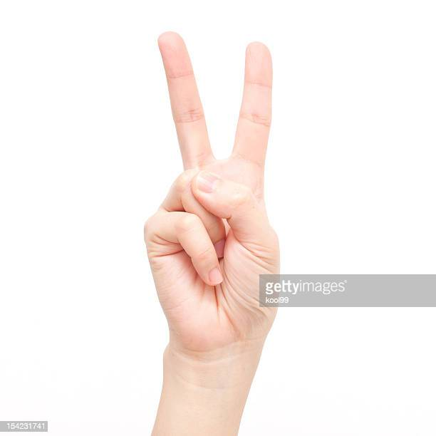 gesture symbols: number two - peace symbol stock photos and pictures