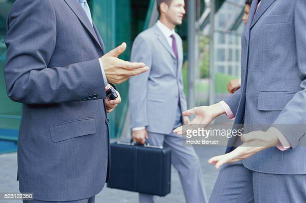 Gesturing Businesspeople