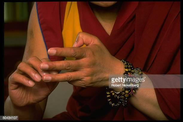 Gesturing hands of exiled Tibetan spiritual ldr. Dalai Lama during TIME interview in Dharamsala, India.