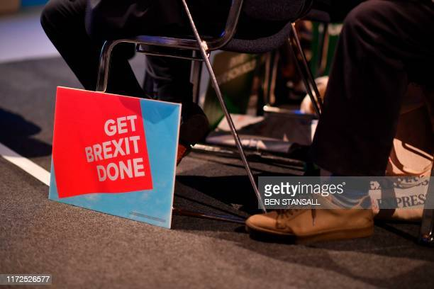 A Get Brexit Done sign is seen on the floor in the main auditorium on the second day of the annual Conservative Party conference at the Manchester...