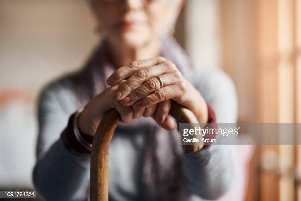i get by with a little help from my cane - senior adult stock pictures, royalty-free photos & images