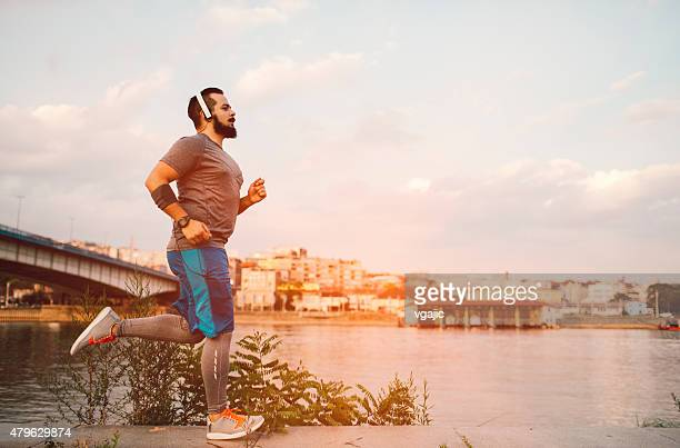 get fit in the city. - chubby men stock photos and pictures
