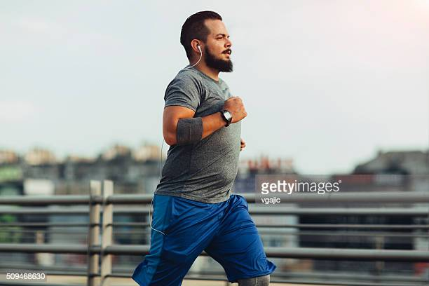 get fit in the city - chubby men stock photos and pictures