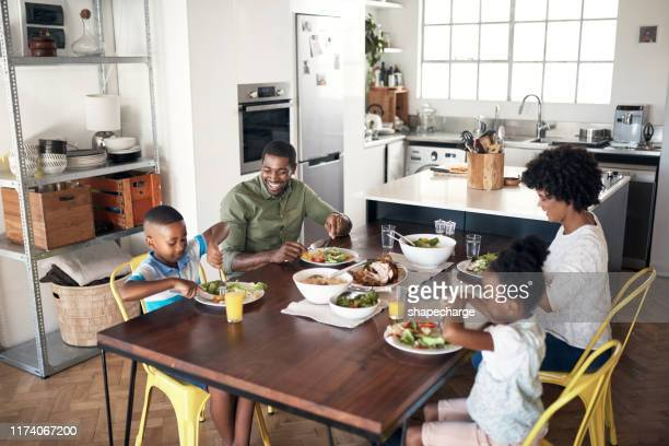 get grubbing with the family - dinner stock pictures, royalty-free photos & images
