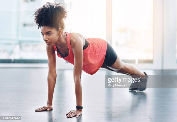 get in as much exercise as you possibly can - push ups stock pictures, royalty-free photos & images