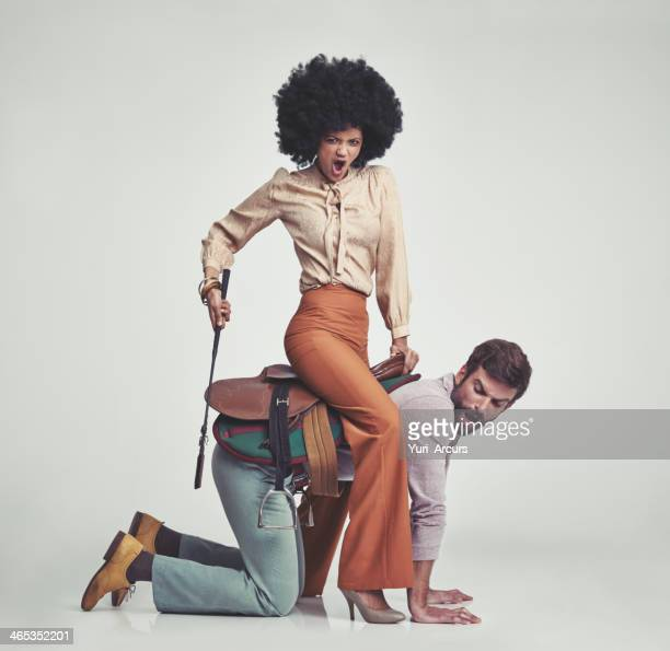 get moving! - women dominating men stock photos and pictures