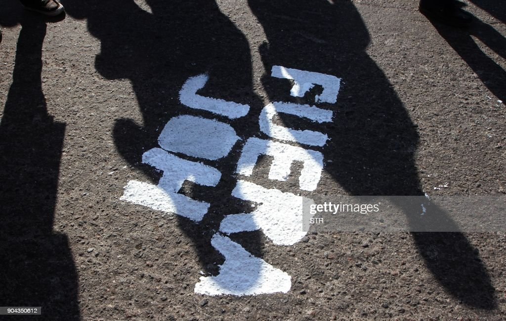 'JOH Get Out' (for President Juan Orlando Hernandez) is seen painted on the street during a protest by supporters of the presidential candidate for the Honduran Opposition Alliance Against the Dictatorship, Salvador Nasralla, in Tegucigalpa on January 12, 2018. Tens of thousands of people protested Friday in the Honduran capital against the reelection of President Juan Orlando Hernandez, as the January 27 start of his second term approaches. /
