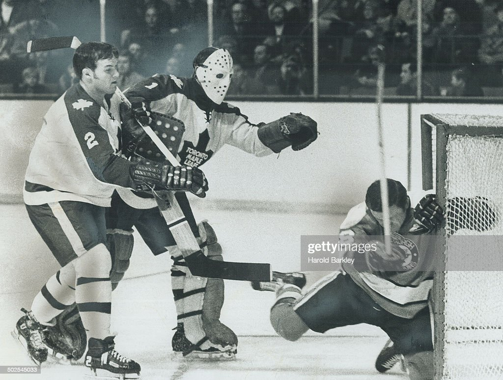 Get outta my net: Leat goalie Jacques Plante was more than irked when Pittsburgh's Wally Boyer (18)  : News Photo