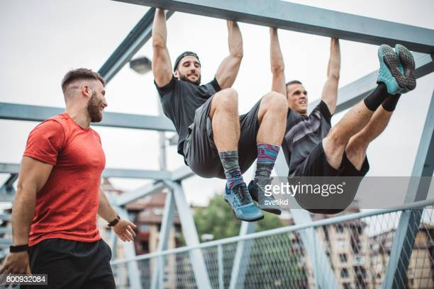 get physical - chin ups stock photos and pictures