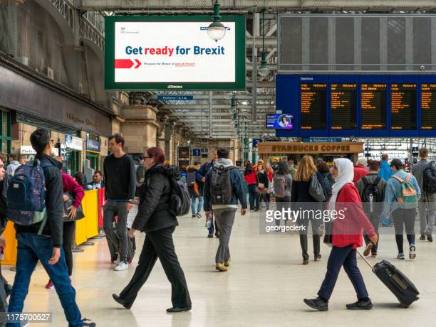 get ready for brexit sign in glasgow central station - brexit stock pictures, royalty-free photos & images