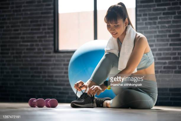 get ready for fitness - tying shoelace stock pictures, royalty-free photos & images