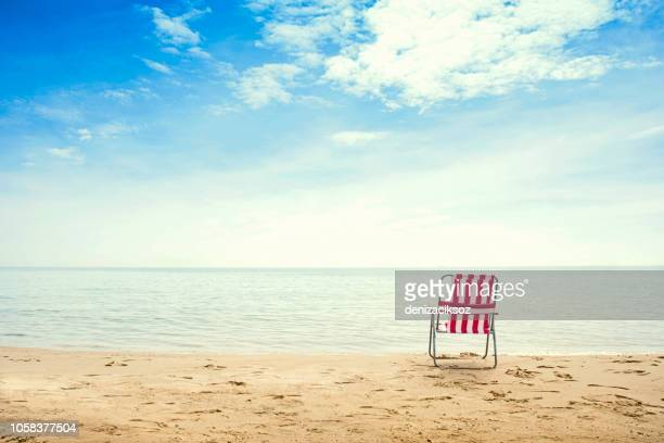get some summer in your life - outdoor chair stock pictures, royalty-free photos & images