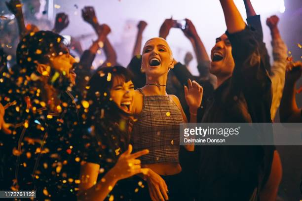 get wild and live a little - popular music concert stock pictures, royalty-free photos & images