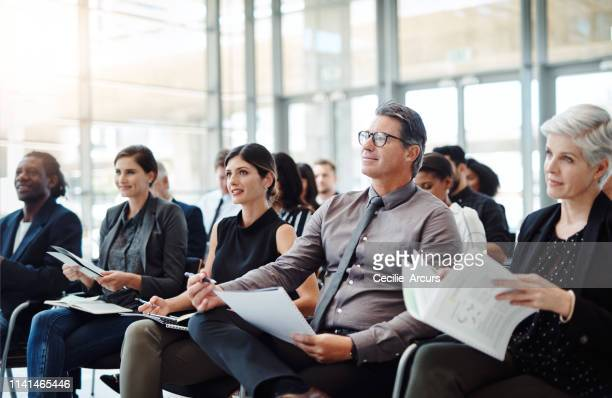 get your notes out and let the learning begin - conference stock pictures, royalty-free photos & images