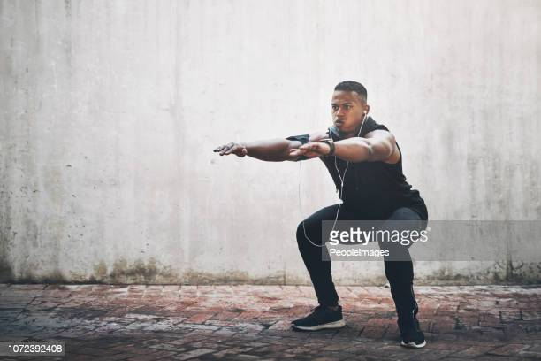 get your squat on - crouching stock pictures, royalty-free photos & images