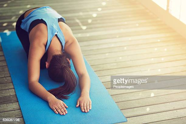 get your yogi on - childs pose stock photos and pictures