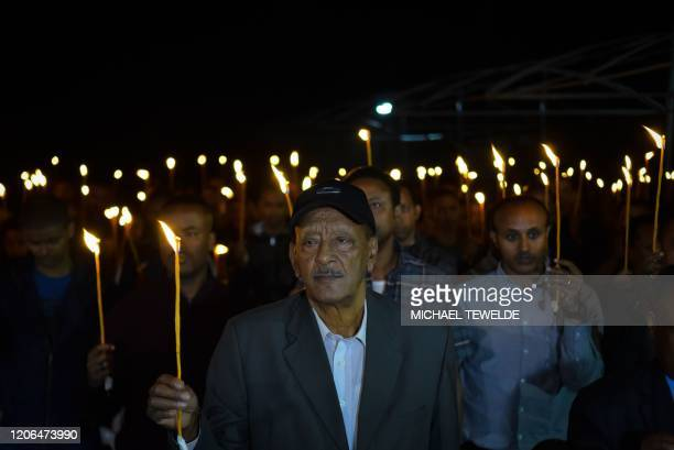 Getachew Tessema father of Ethiopian Airlines Flight 302 captain Yared Getachew holds a candle during a commemoration ceremony held by the Airline...