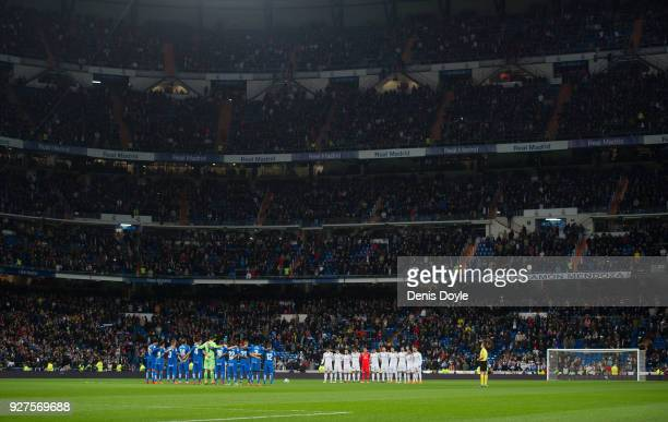 Getafe and Real Madrid players hold a minute of silence in memory of former Sporting Gijon and Barcelona player Enrique Castro 'Quini' before the La...