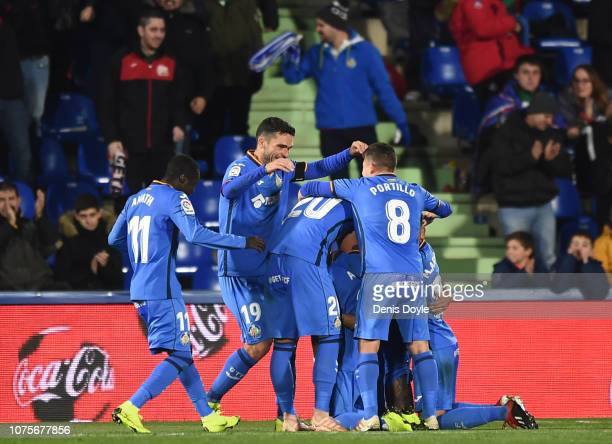 Getafe players celebrate after scoring their 3rd goal during the La Liga match between Getafe CF and RCD Espanyol at Coliseum Alfonso Perez on...
