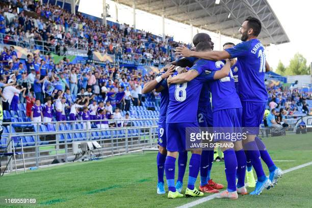 Getafe players celebrate their opening goal scored by Getafe's Spanish forward Angel Rodriguez during the UEFA Europa League group C match Getafe...