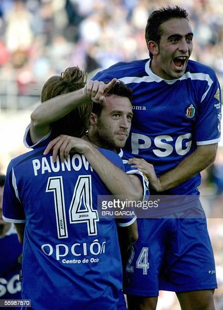 Getafe's Paunovic Alberto and Riki celebrate the third goal against Zaragoza during their Spanish League football match at the Alfonso Perez Coliseum...