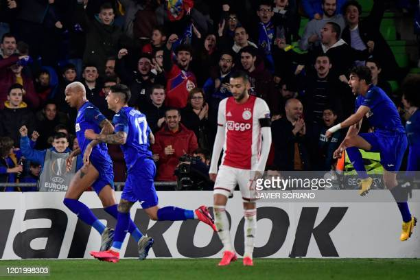 Getafe´s Brazilian forward Deyverson celebrates after scoring during the Europa League round of 32 football match between Getafe CF and Ajax...
