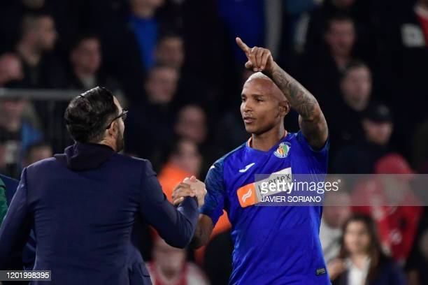 Getafe´s Brazilian forward Deyverson celebrates with Getafe's Spanish coach Jose Bordalas after scoring during the Europa League round of 32 football...