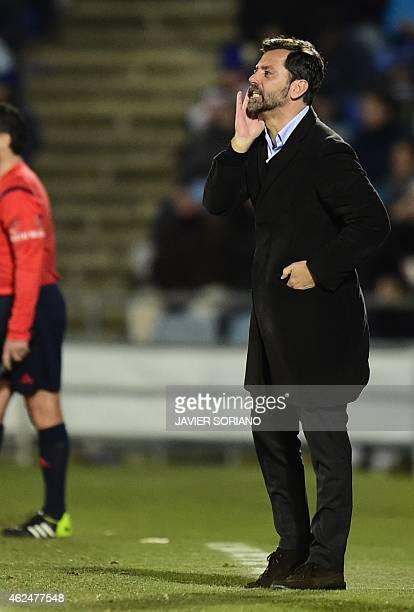 Getafe's coach Quique Sanchez Flores gestures during the Spanish Copa del Rey quarter final second leg football match Getafe CF vs Villarreal CF at...