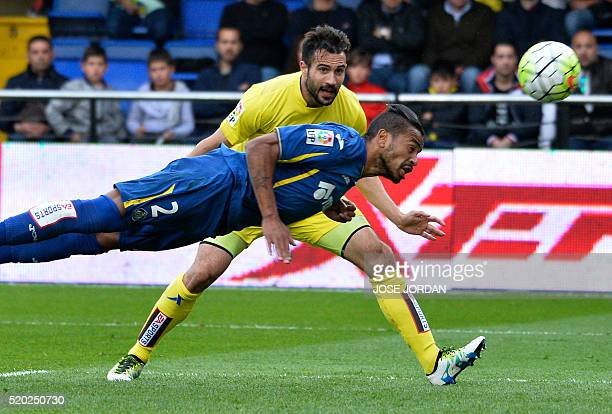 Getafe's defender Alovaro Pereira heads the ball past Villarreal's defender Mario during the Spanish league football match Villarreal CF vs Getafe CF...