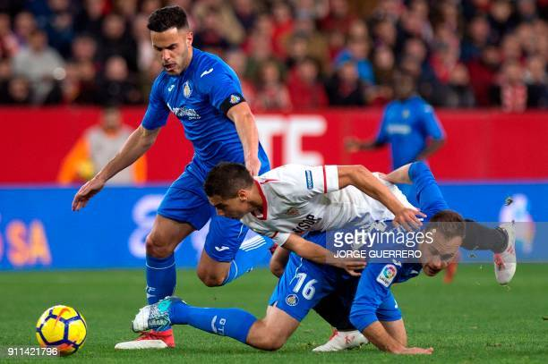 Getafe's defender Bruno Gonzalez and defender Juan Torres 'Cala' vie with Sevilla's French forward Wissam Ben Yedder during the Spanish league...