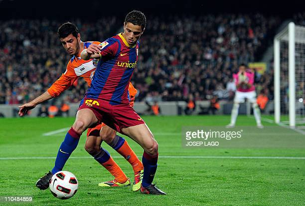 Getafe's defender Miguel Torres Gomez vies with Barcelona's Dutch Ibrahim Afellay during the Spanish league football match FC Barcelona vs Getafe on...